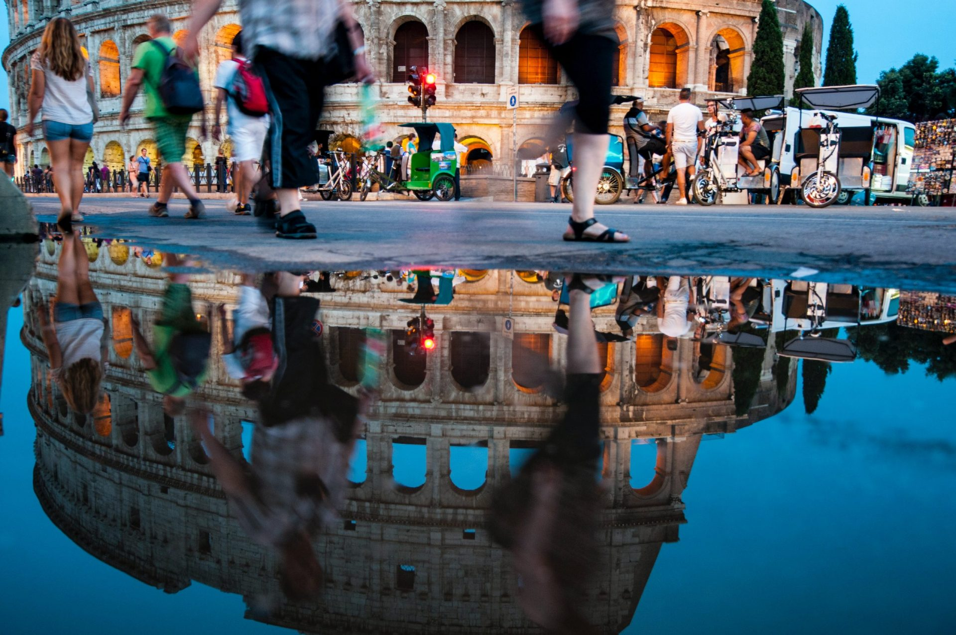 10 Common Travel Photography Mistakes - Colosseum in Rome reflection with slow shutter people movement