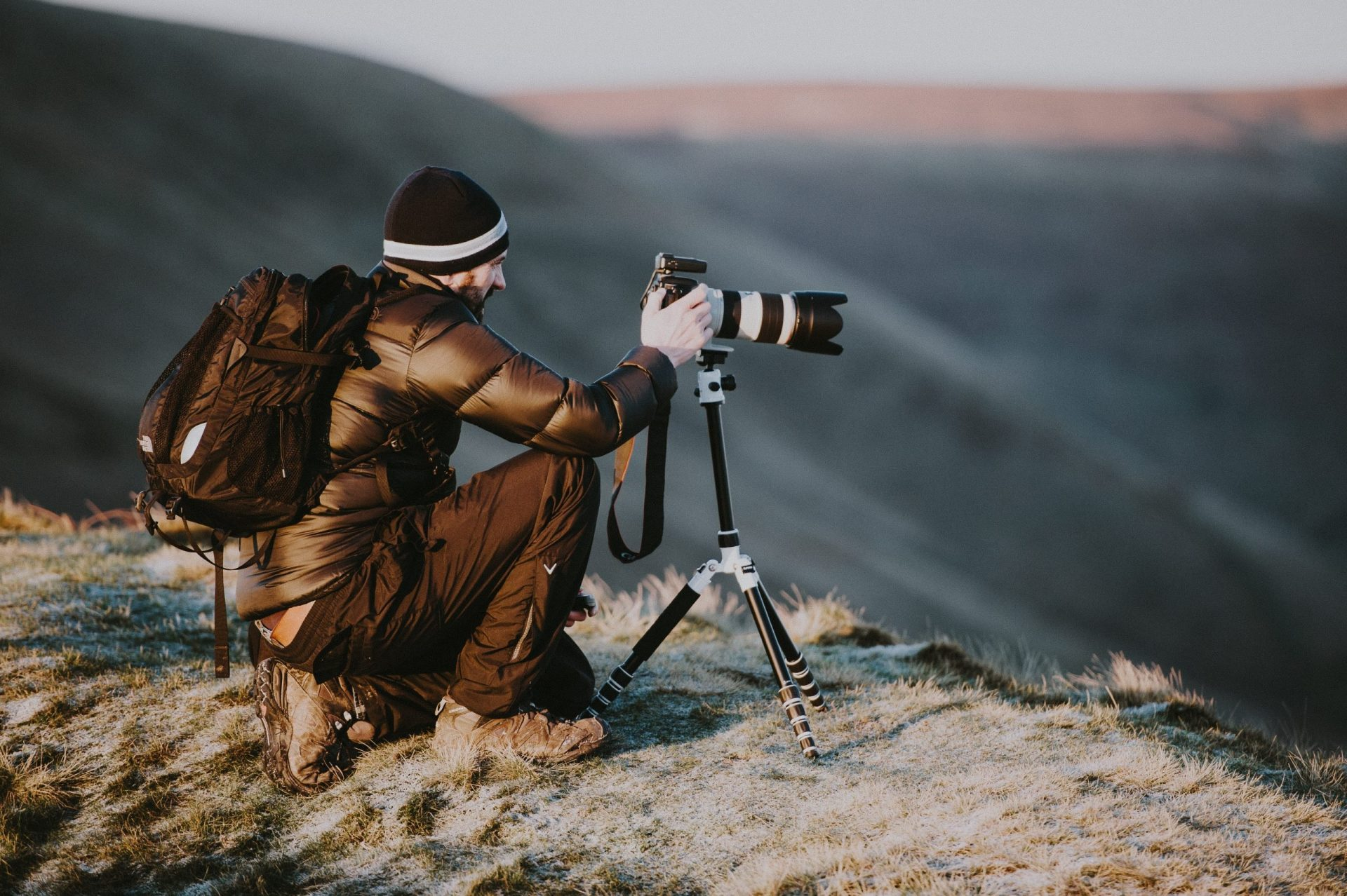 Travel Photography - how to take great pictures while traveling - Man with camera in mountains