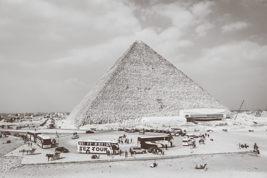 8 Travel Tips for Egypt to Improve Your Egyptian Adventure - tourist buses at the Great Pyramid in Giza