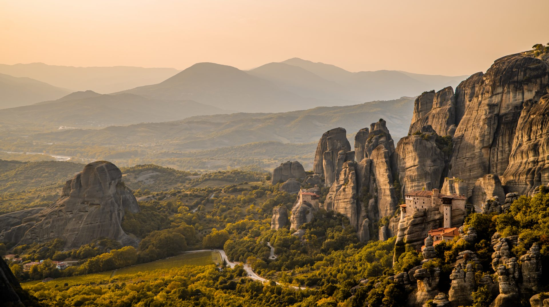 Amazing sunset panorama of the valley of Meteora, Thessaly, Greece with Rousanou monastery
