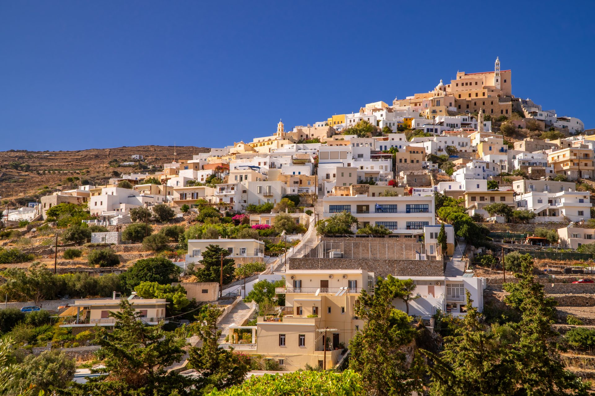 Digital Nomad Greece Guide - Panoramic view of the town of Ano Syros - the old town of Ermoupoli, Syros - Cyclades, Greece