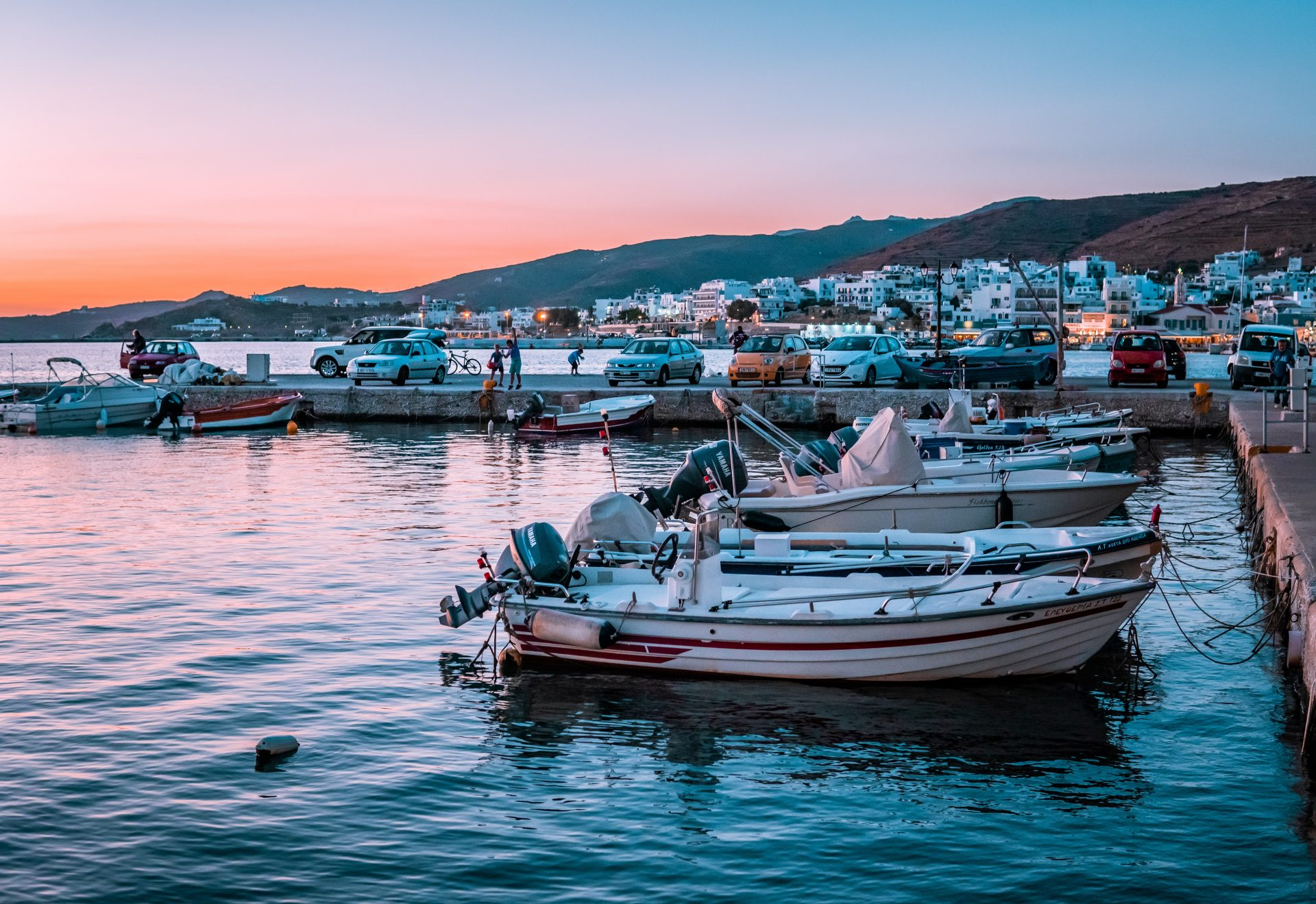 Digital Nomad Greece Guide - boats in Tinos at sunset