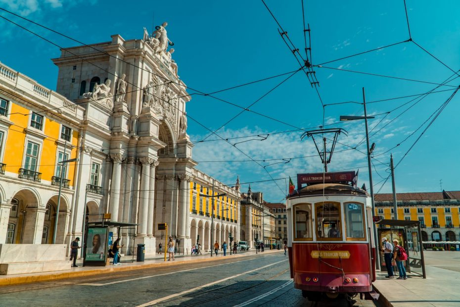 Digital Nomad Portugal Guide - featured - old tram on Praca do Comercio in Lisbon