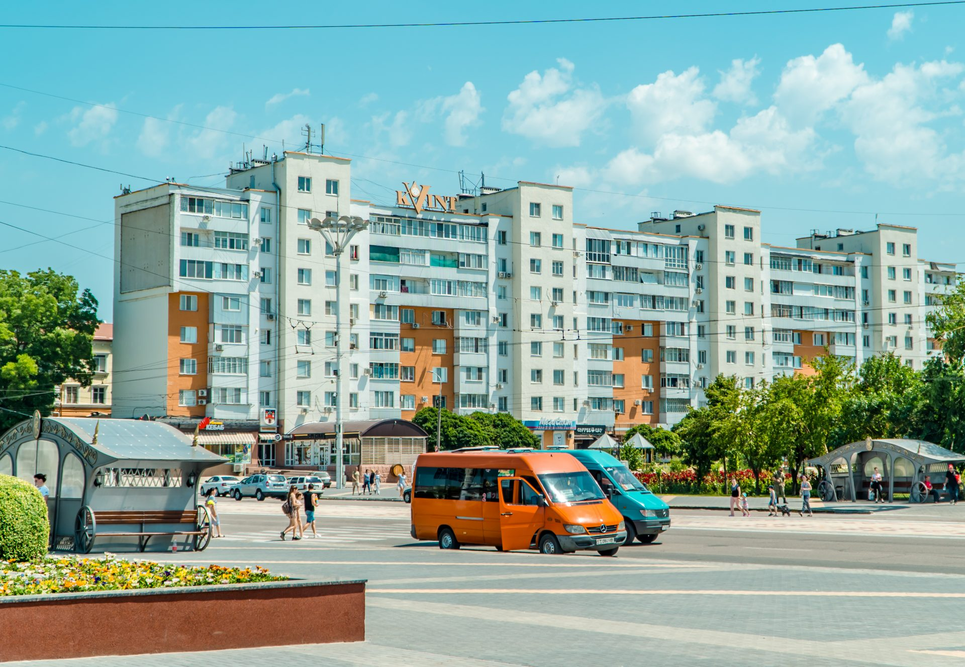 Soviet-style buildings and cars in the center of Tiraspol