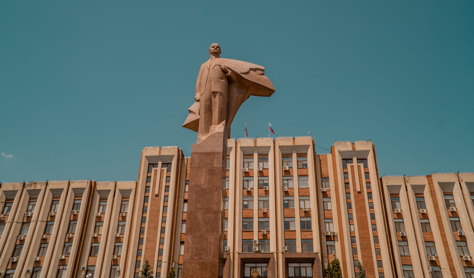Travel to Transnistria - sunset view Lenin statue in front of the Supreme Council in Tiraspol