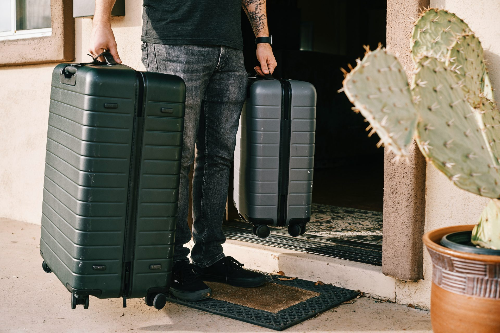 The Ultimate Digital Nomad Packing List - man with two suitcases