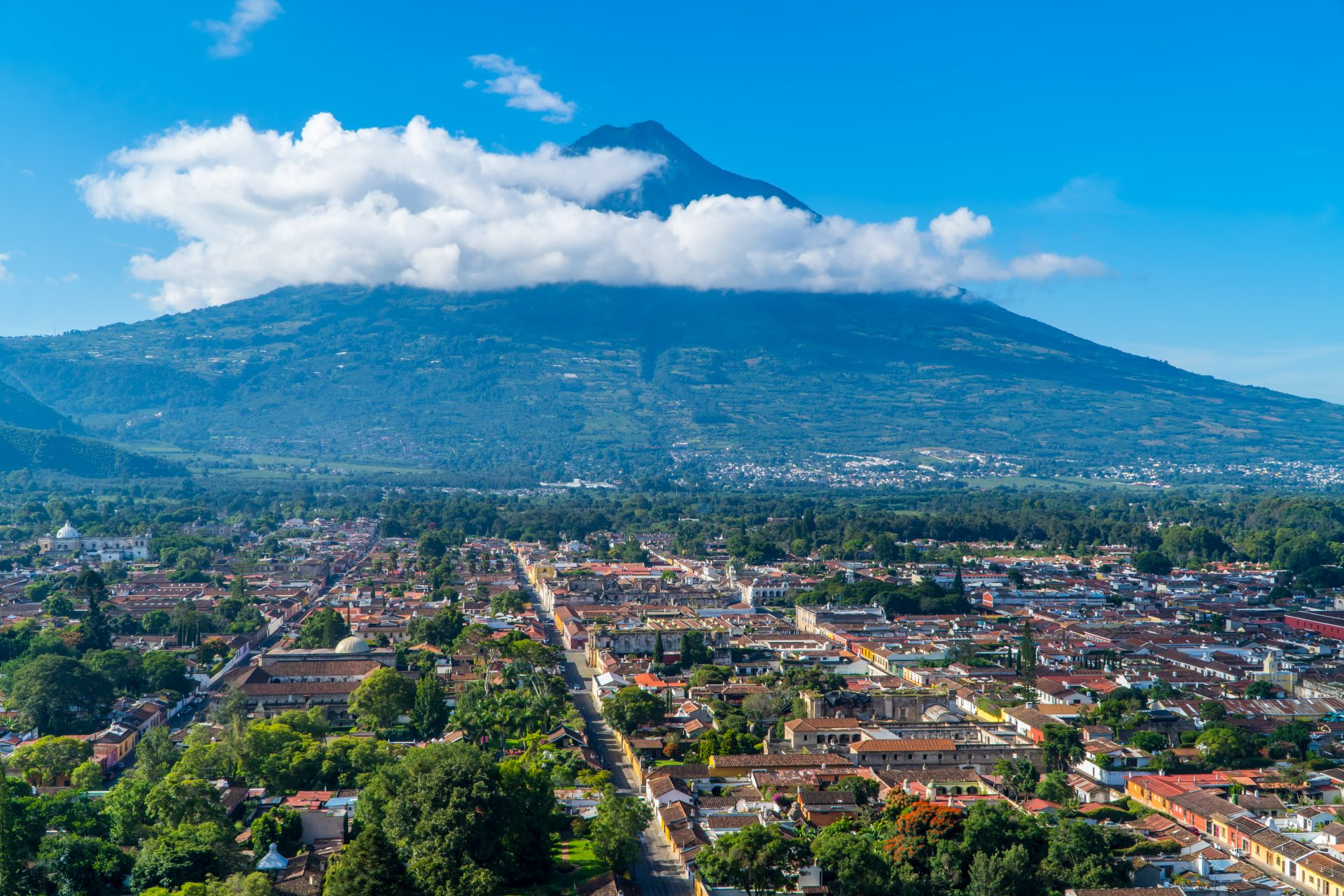 Things to do in Antigua Guatemala - featured - Panoramic aerial view of the city of Antigua, Guatemala with Agua Volcano